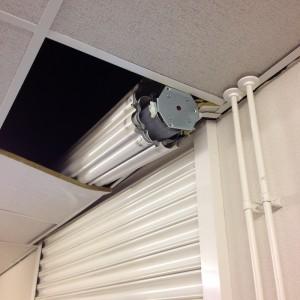 Schade-rolluik-uit-plafond